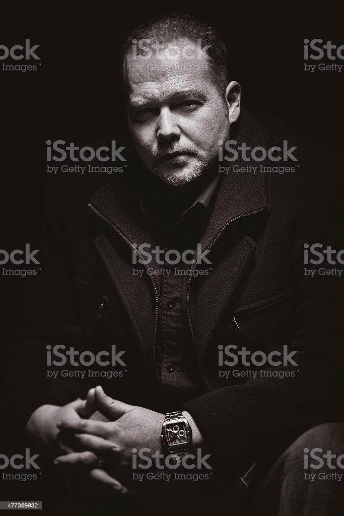 Mobster in a dark stock photo