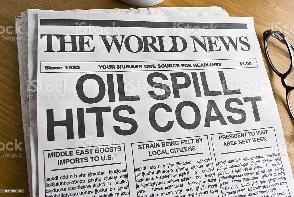 Mock newspaper headline of 'Oil Spill' as current affair.  royalty-free stock photo
