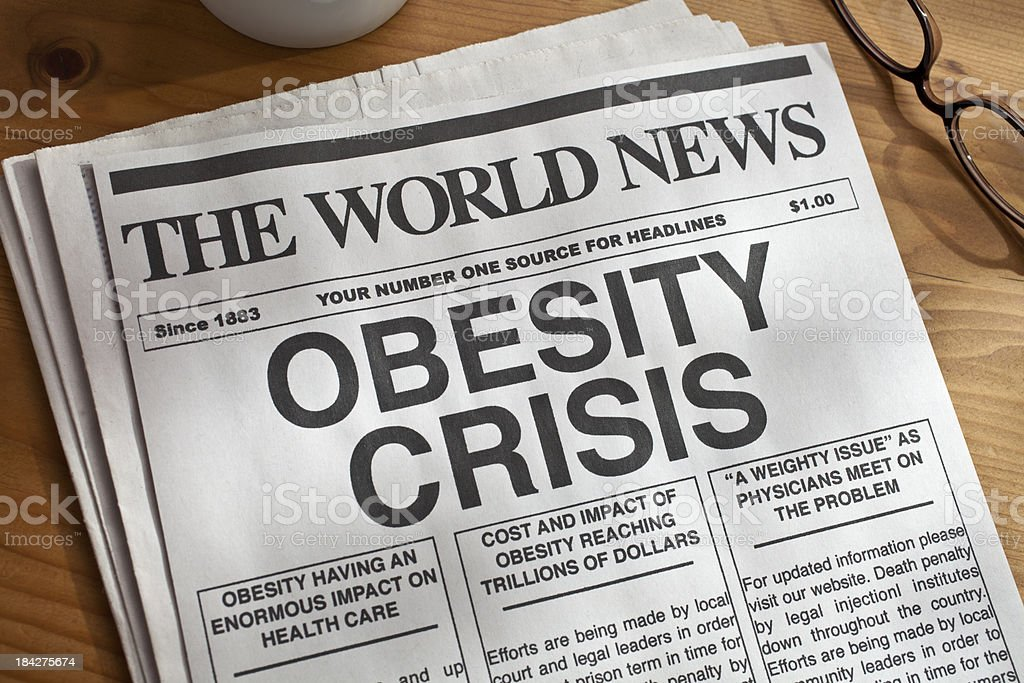 Mock newspaper with big headline on obesity crisis royalty-free stock photo