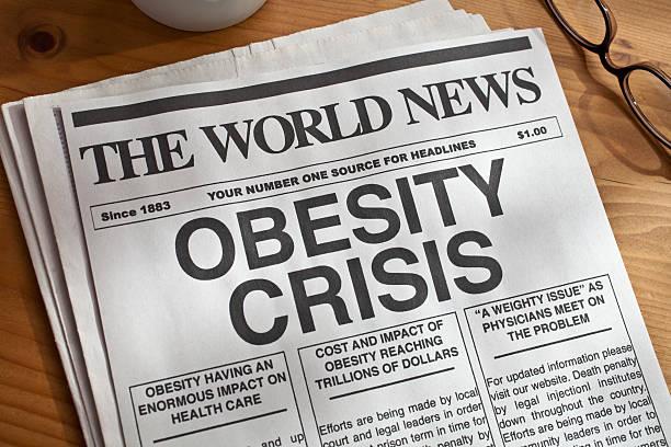 Mock newspaper with big headline on obesity crisis stock photo