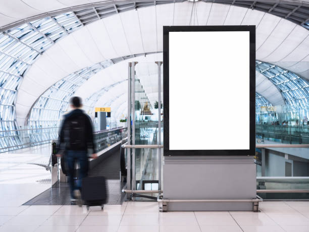 mock up banner media light box with people public building - airport stock photos and pictures