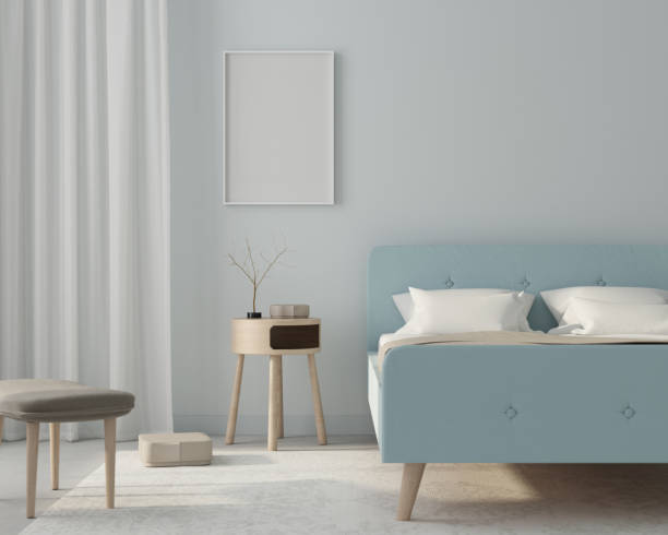 Mock up bedroom interior in a light blue color with poster. 3d render stock photo