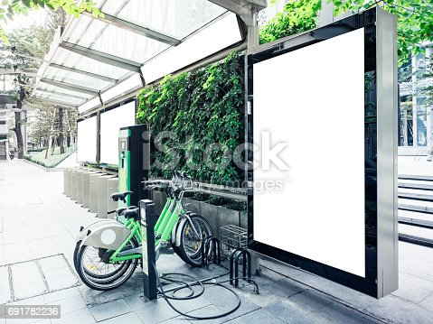 istock Mock up Billboard at Bus Station with Public Bicycle parking 691782236
