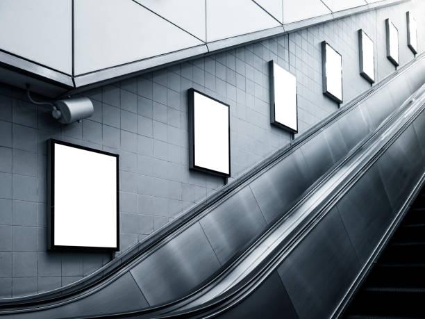 mock up billboard poster ads escalator side subway station - escalator foto e immagini stock