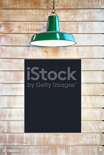 istock Mock up Blackboard Poster with lighting on wooden wal 577980020