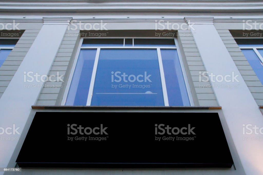 Mock up. Blank billboard outdoors, outdoor advertising, public information board on the wall under window foto stock royalty-free