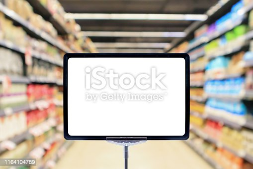 istock Mock up blank price board poster sign display with supermarket aisle abstract background 1164104789