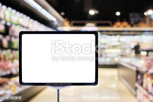 istock Mock up blank price board poster sign display with supermarket aisle abstract background 1167452919