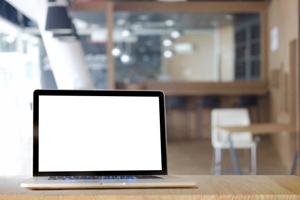 Mock up Blank screen of Laptop on marble table in Co-working or cafe. stock photo