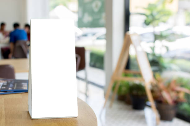 mock up blank template menu frame on wood table in restaurant with blurred background, clipping path included - vinyl banner mockup stock photos and pictures