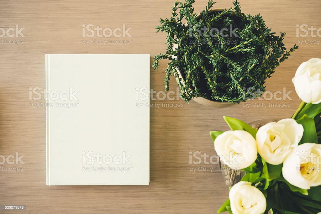 Mock up Book cover on table with White rose Flower stock photo
