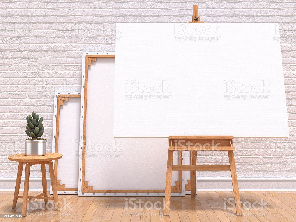 Mock up canvas frame with plant, easel, floor and wall stock photo