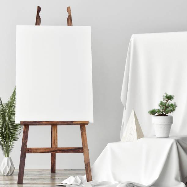 Mock-up Leinwand im Atelier des Künstlers, zwei rose Hocker – Foto