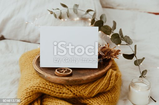 istock Mock Up Card. Background With Warm Sweater, and  Decorations in Bed. Morning Sweet Home, Still Life Concept. Flat lay, Top view, Copy Space 924613736