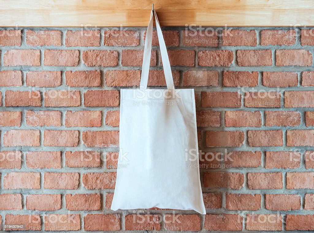 Mock up Cotton Tote Bag on Brick wall Background stock photo