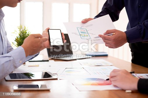 istock Mock up. Creative designers planning work together on applications on mobile phone and websites. 1159056033