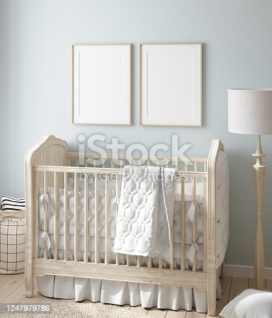 1208254907 istock photo Mock up frame in boy nursery with natural wooden furniture 1247979786