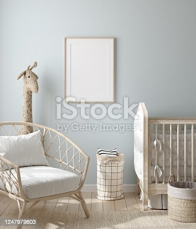 1208254907 istock photo Mock up frame in boy nursery with natural wooden furniture 1247979803