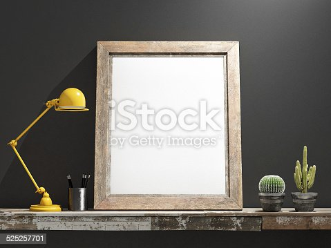 istock Mock up Frame on Wooden table, grey wall 525257701