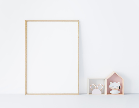 Mock up frame poster in kids room with wooden frame and children toys, stock photo