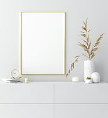Mock up golden frame in white interior with simple modern decor, Scandinavian style, 3d render