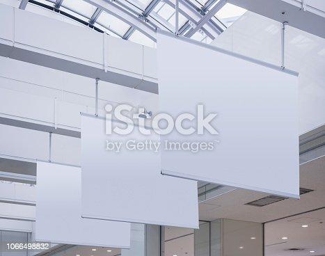 istock Mock up Hanging Poster indoor building Media Advertising 1066498832