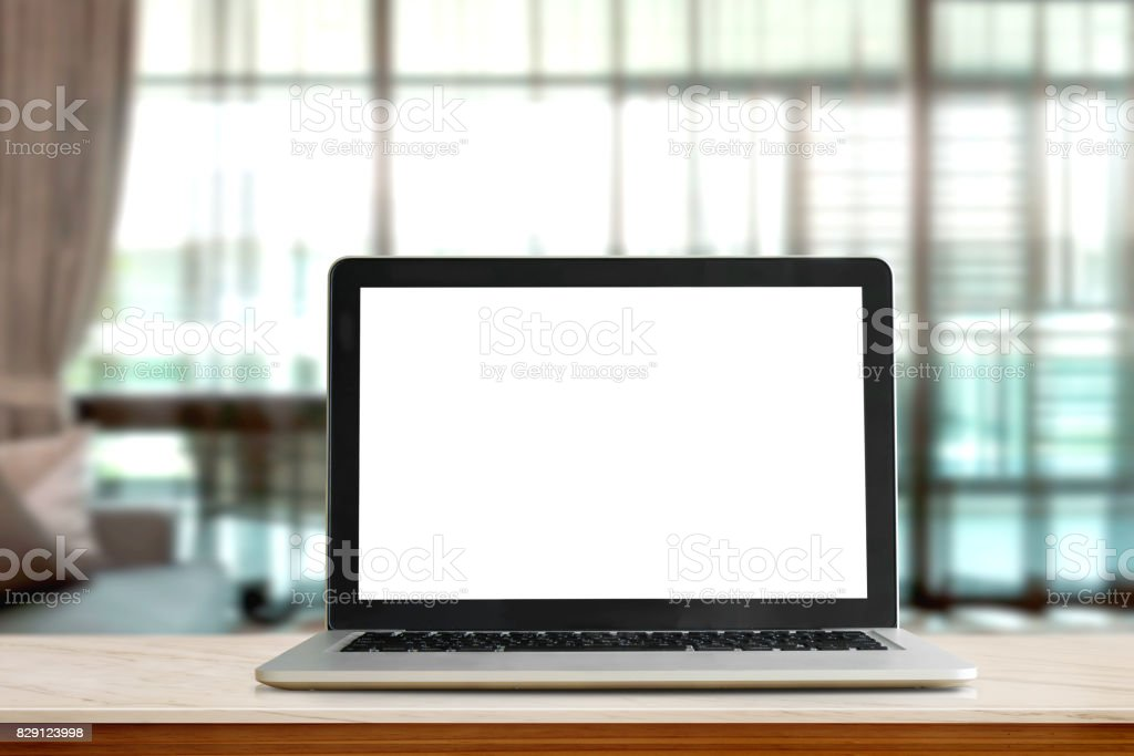 Mock up Laptop Blank screen on marble table in living room. stock photo