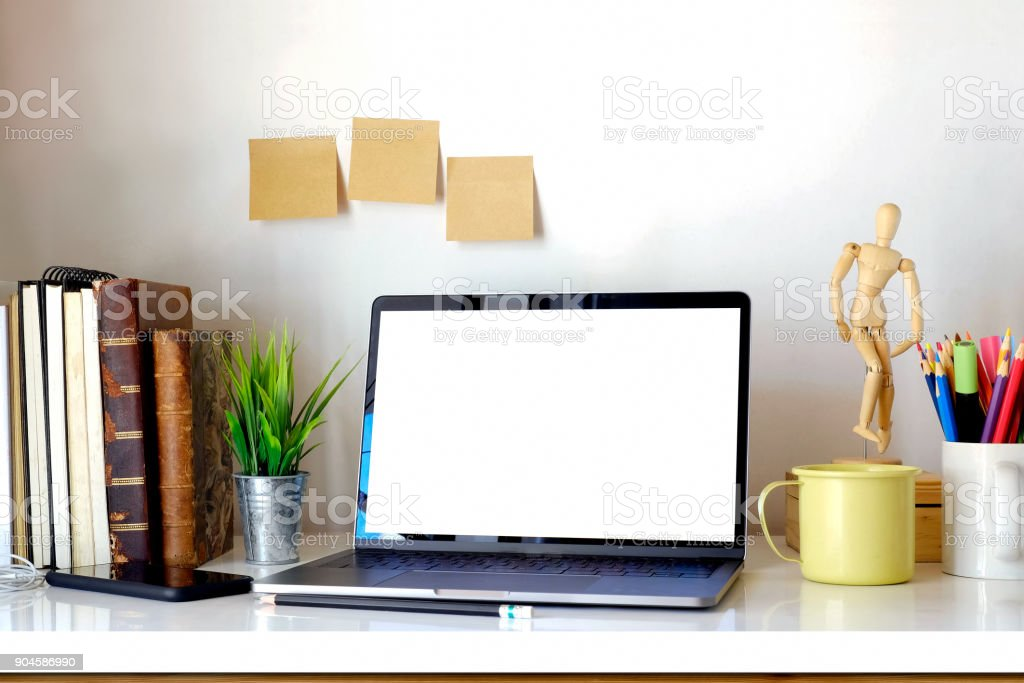 Designer or Stylish workspace with Laptop computer, office supplies...