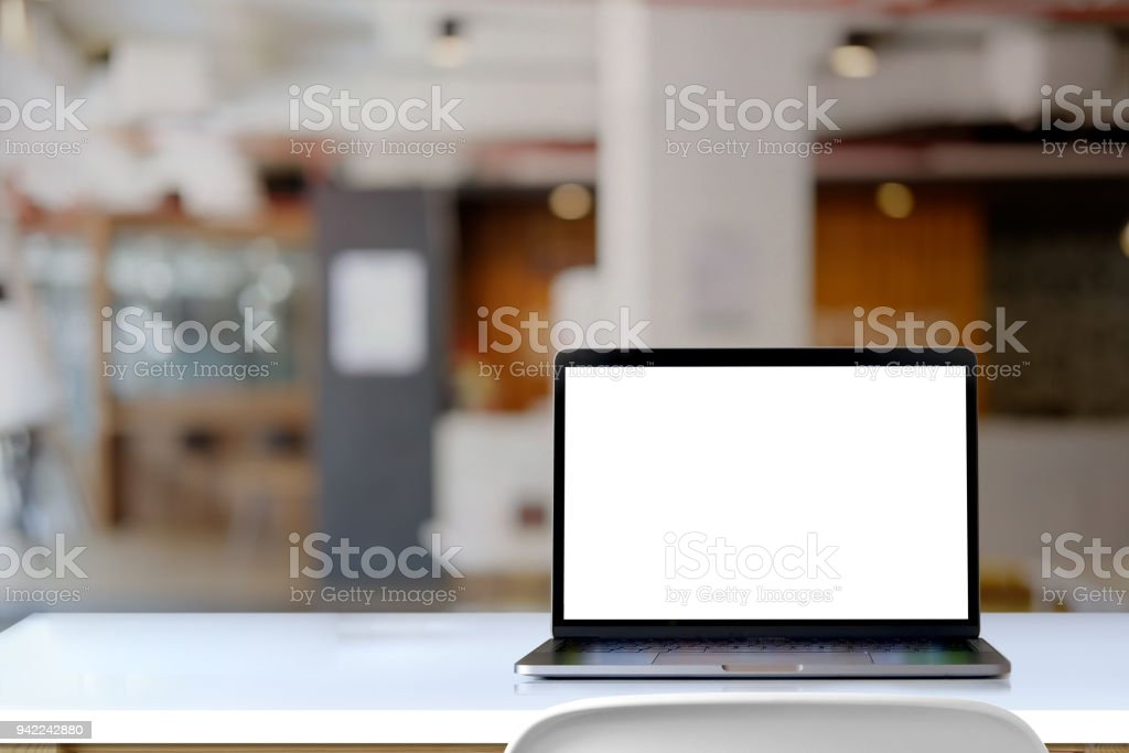 Mock up laptop on desk in office. stock photo