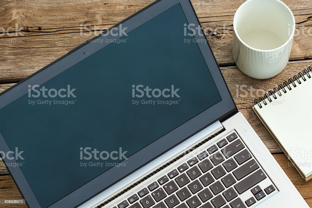 Mock Up laptop on Old Wood Texture Background stock photo