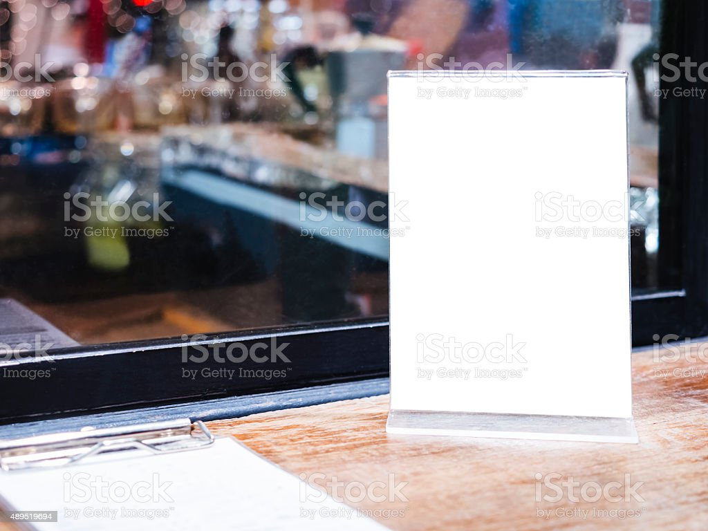 Mock up Menu frame on Table in Bar restaurant cafe stock photo