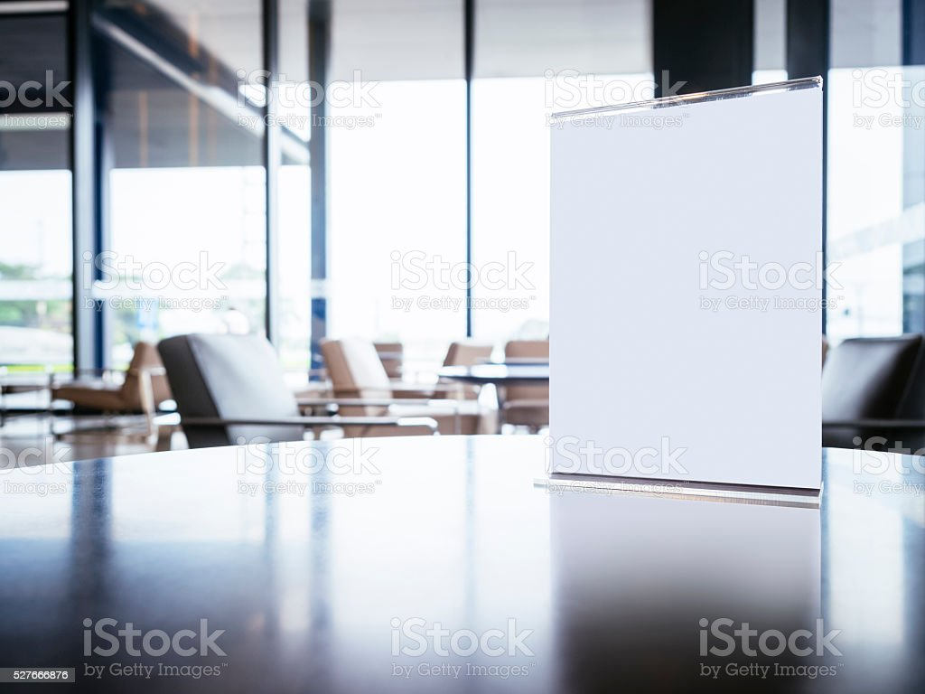 Mock up Menu Frame on Table in Lobby area Background stock photo