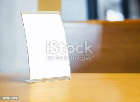 istock Mock up Menu frame on Table in restaurant cafe 489486686