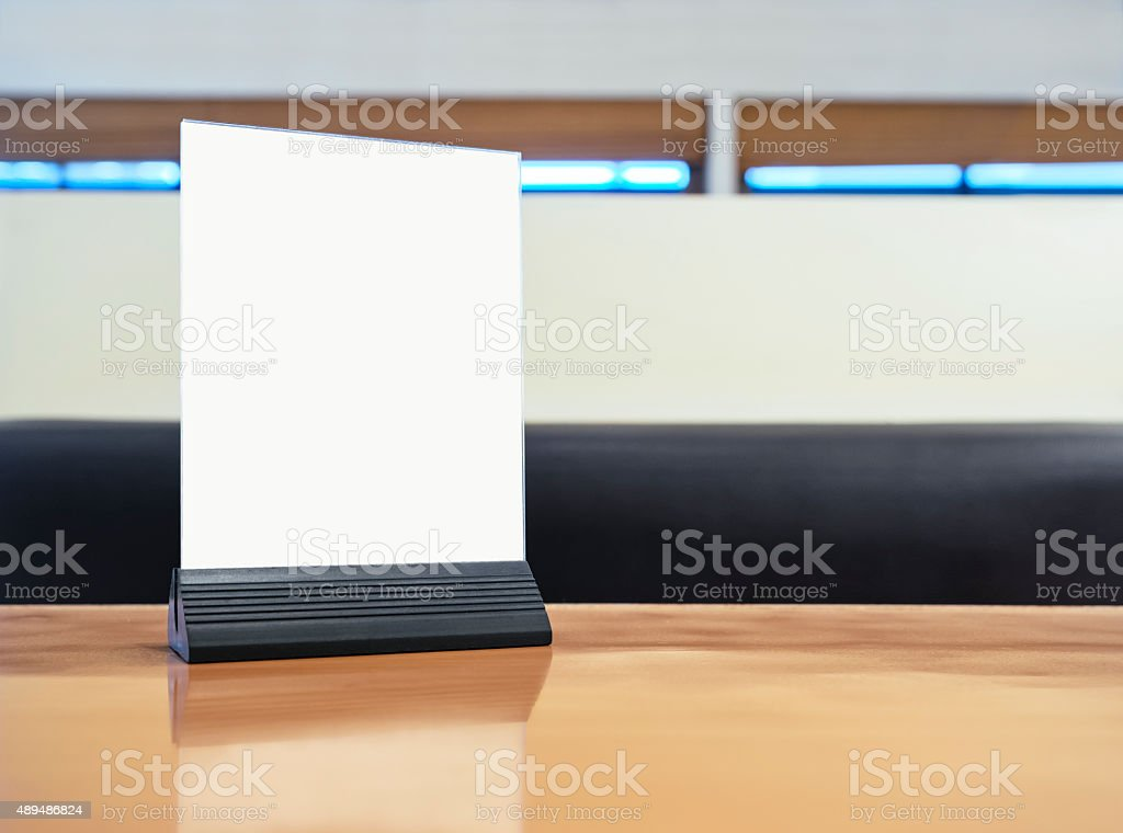 Mock up Menu frame on Table in restaurant cafe stock photo