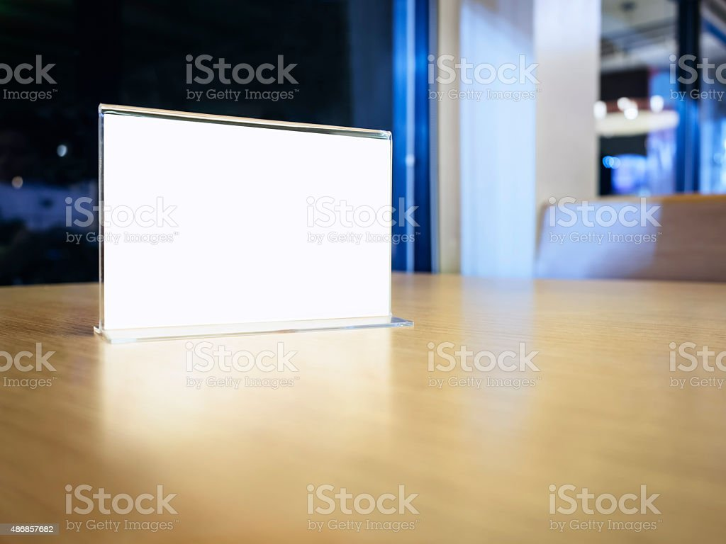 Mock up Menu frame on Table in Restaurant Cafe shop stock photo