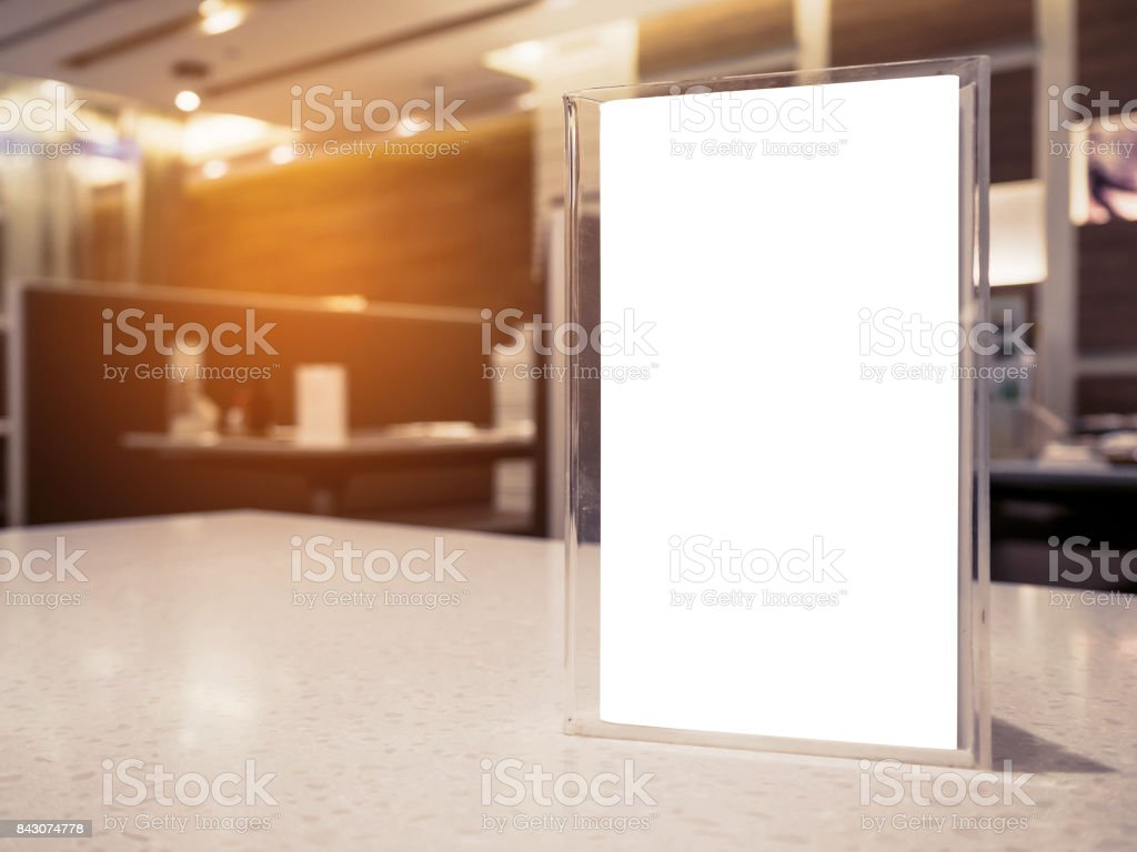 Mock up menu frame on table in the cafe restaurant stock photo
