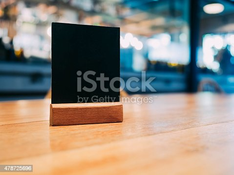 istock Mock up Menu frame on Table with Blurred restaurant cafe 478725696