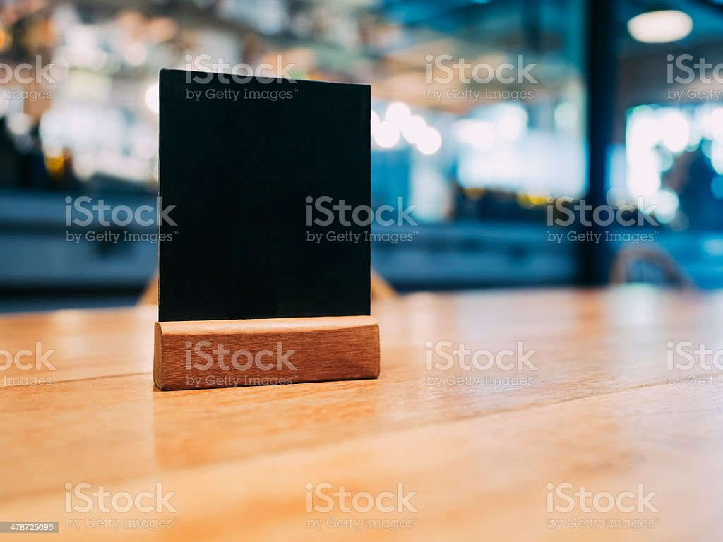 Mock up Menu frame on Table with Blurred restaurant cafe stock photo