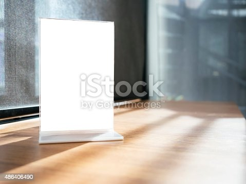 istock Mock up Menu frame on Table with Restaurant Cafe Shop 486406490