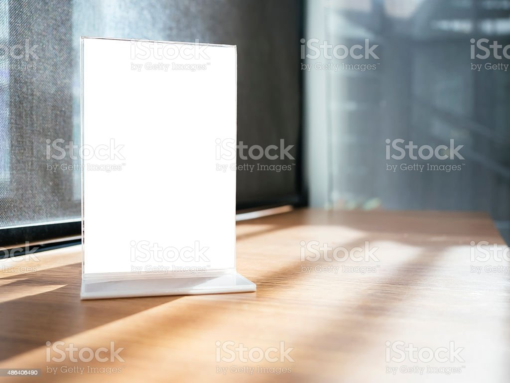 Mock up Menu frame on Table with Restaurant Cafe Shop stock photo