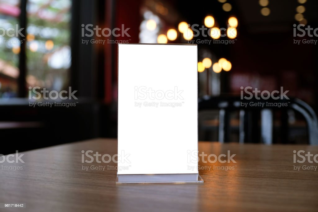 Mock up Menu frame standing on wood table in Bar restaurant cafe. space for text stock photo