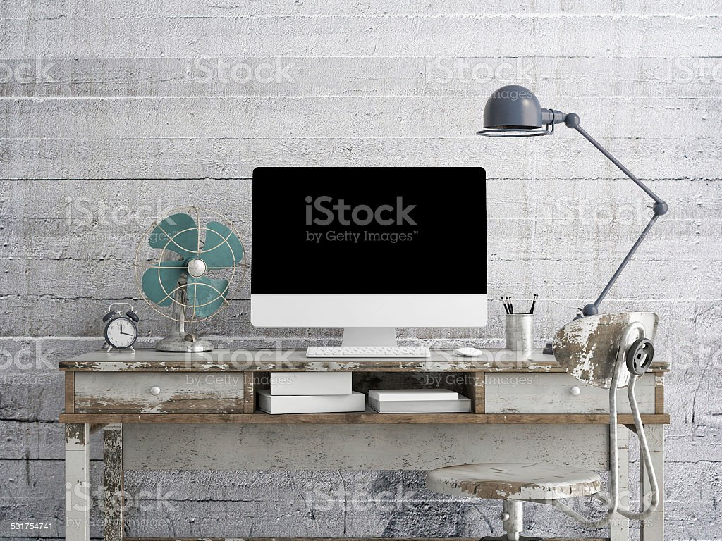 Mock up monitor on table, concrete background stock photo