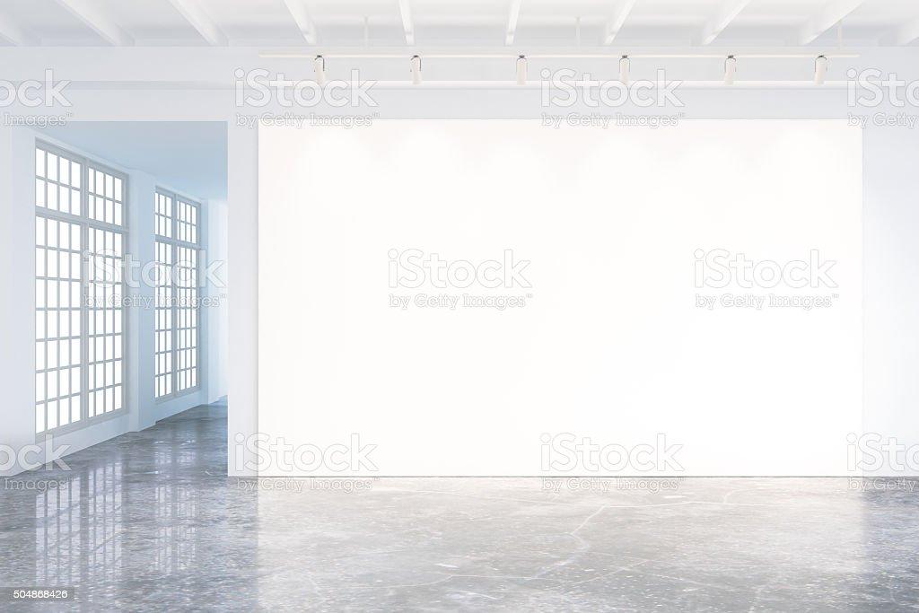 Mock up of blank poster in modern loft interior stock photo