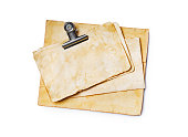 istock Mock up of empty old vintage yellowed paper sheets with clip 1129071071