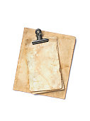 istock Mock up of empty old vintage yellowed paper sheets with clip 1129071078