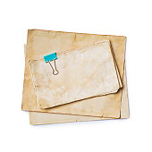 istock Mock up of empty old vintage yellowed paper sheets with clip 1129071082