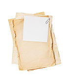 istock Mock up of empty old vintage yellowed paper sheets with clip 1149717804