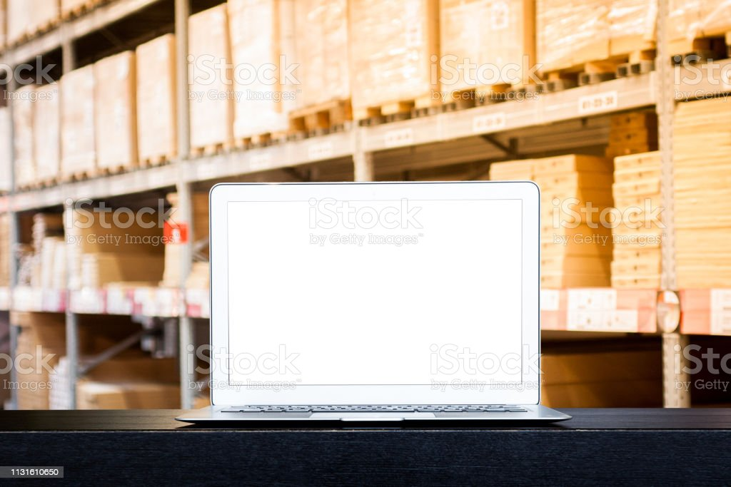 Mock up of modern computer or laptop with blank screen on table with...