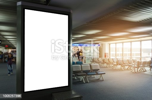 istock mock up of vertical blank advertising billboard or light box showcase with waiting cone at airport, copy space for your text message or media content, advertisement, commercial and marketing concept 1005257396