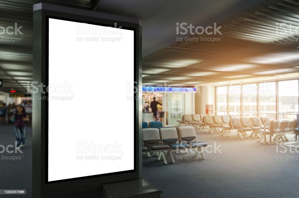 mock up of vertical blank advertising billboard or light box showcase with waiting cone at airport, copy space for your text message or media content, advertisement, commercial and marketing concept stock photo